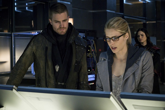 Stephen Amell as Oliver Queen and Emily Bett Rickards as Felicity Smoak  © 2015 The CW Network, LLC. All Rights Reserved.