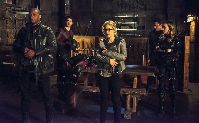 Katie Cassidy as Laurel Lance, Emily Bett Rickards as Felicity Smoak, and David Ramsey as John Diggle © 2015 The CW Network, LLC. All Rights Reserved.