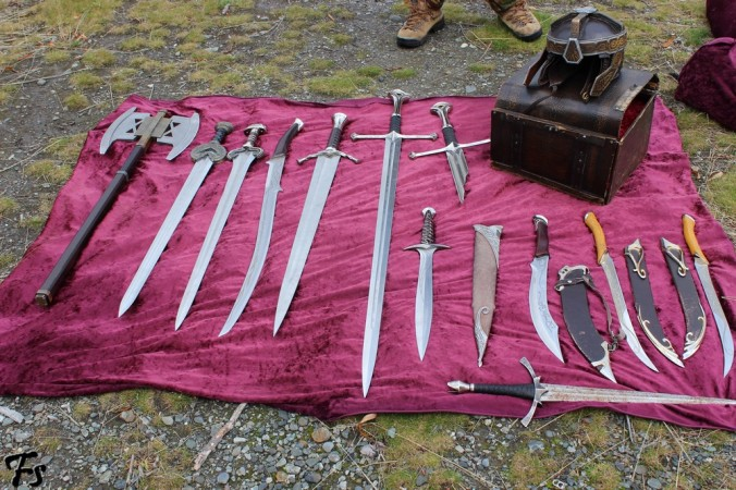 From left to right: Gimli's axe, Herugrim, Éowyn's sword, Hadhafang, Boromir's sword, Andúril, (top) shard of Narsil, (bottom) Sting, Aragorn's dagger, Legolas' daggers, Morgul blade, Gimli's helmet